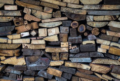 Firewood stacked vertically along the wall Royalty Free Stock Photo