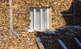 Firewood stacked in winter Stock Photo