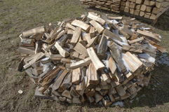 Firewood stacked in winter. Royalty Free Stock Photography