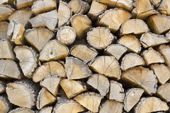 Firewood stacked in the woodpile Royalty Free Stock Photography