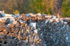 Woodpile. Firewood stacked in a woodpile. Large stock of firewood stock photography