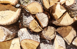 Firewood stacked in a woodpile Royalty Free Stock Photos