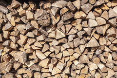 Firewood stacked in a woodpile in the yard Stock Images