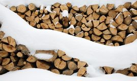 Firewood stashed in winter Stock Photos