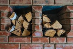 Firewood stored in a house. stock photos