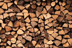 Firewood texture. Firewood stock for the winter in the mountain village of Zerba, Valtrebbia, Italy royalty free stock image