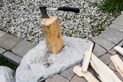 Firewood tree and small ax royalty free stock images
