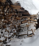 Firewood under snow Stock Photo