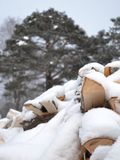Firewood under snow Royalty Free Stock Image