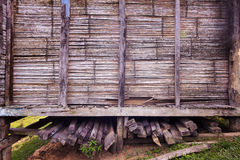 Firewood under traditional bamboo hut in Borneo Royalty Free Stock Images