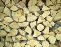 Firewood. Unusual background may be a firewood. Different forms, carefully folded, firewood remind ambulance cold winter royalty free stock photography