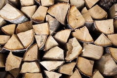 Firewood wall. Woodpile. Firewood wall. Logs stacked in the woodpile Royalty Free Stock Images