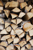 Firewood wall. Woodpile. Firewood wall. Logs stacked in the woodpile stock images