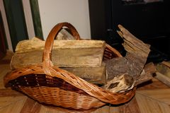 Firewood in a wicker basket royalty free stock photo