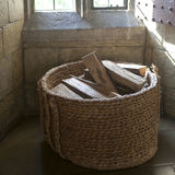 The Firewood in a wicker basket in the sauna Royalty Free Stock Photo
