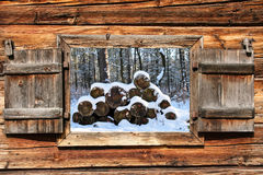 Firewood through a window Royalty Free Stock Images