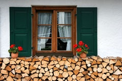 Firewood and window Stock Images