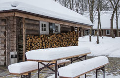 Firewood for winter. A log cabin with firewood stocked up for the winter Stock Photography