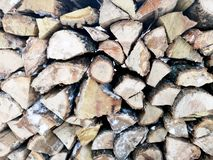 Firewood in winter. The texture of impaled wood in the snow stock photos