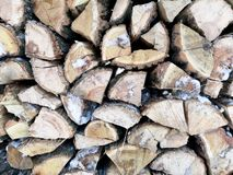 Firewood in winter. The texture of impaled wood in the snow royalty free stock images