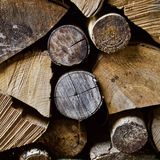 Firewood in a winter woodpile. Firewood split and stacked in a winter woodpile in Vermont Royalty Free Stock Images