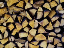 Firewood. Wood chopped logs stacked like firewood at each other royalty free stock image