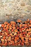 Firewood wood pile stacked triangle shape Stock Images