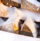 Firewood, wood with snow in winter Stock Images