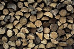 Firewood in woodpile. Prepared for Winter. Pile of firewood. The firewood background. A stack of neatly stacked, dry firewood outdoors stock photos