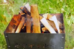 Firewoods in barbecue (grill) Stock Images