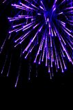 Firework. A blue flare in the night sky Stock Images