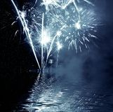 Firework. Celebratory Firework reflection in water Stock Photo