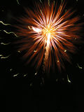 Firework. In the dark night sky flash brightly firework. Somebody has birthday, celebrate The day of victory or just party Stock Photo