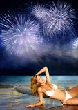 Firework. Beautiful girl on the beach and firework stock image
