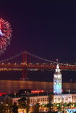 Firework above Ferry Building & Bay Bridge Royalty Free Stock Photo