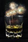 Firework on alcohol glass Stock Photo