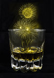 Firework on alcohol glass Royalty Free Stock Images