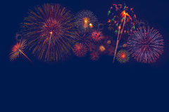 Firework background. Multiple fireworks exploding high in the sky can use for background Stock Images