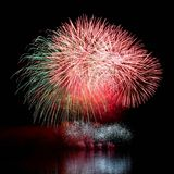 Firework. Beautiful colorful fireworks on the water surface with a clean black background. Fun festival and contest of Firefighter Stock Photos