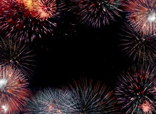 Firework border. Border (frame) composed of firework flares isolated on black background with empty copy space in the middle to insert some text or images Stock Photography