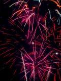 Firework Bursts Close Up Long Exposure. A close up long exposure of red firework bursts Royalty Free Stock Image
