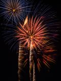 Firework Bursts. A long exposure of several firework bursts, red, white, blue and orange in color Royalty Free Stock Image
