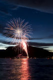 Firework Celebration at Night on Water Royalty Free Stock Images