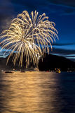 Firework Celebration at Night on Water Royalty Free Stock Photography