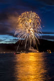 Firework Celebration at Night on Water Stock Photography