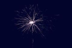 Firework. Christmas background - little firework closeup at night Stock Photos