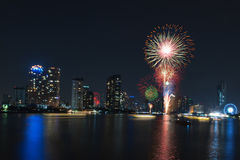 Firework display for celebration. On the river Stock Photography