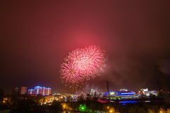 Firework display in the night city, Stock Images