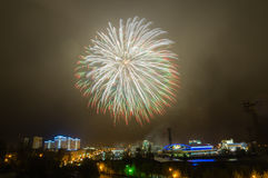 Firework display in the night city, Stock Photography