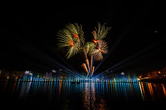 Firework displays and fireworks. Fireworks Celebration Event.Shiny surface reflects light. Nong Prajak park Udon Thani, Thailand Stock Photo
